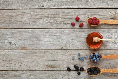 Healthy morning meals background. Tasty ingredients in wooden spoons