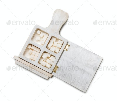 Wooden box with white sugar cubes isolated
