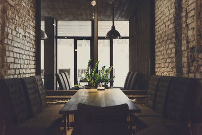 Cozy dining place at window, restaurant background