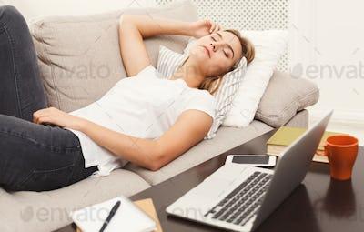 Casual blonde girl sleeping on the sofa