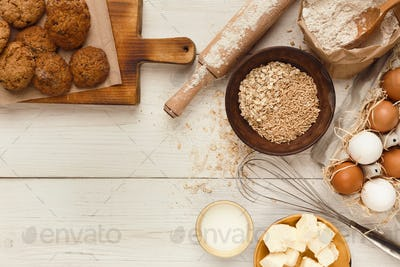Oatmeal cookies and baking ingredients for homemade pastry background