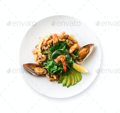 Warm salad with grilled seafood isolated