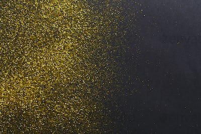 Golden glitter sand texture, abstract background.