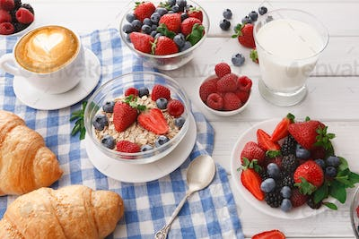Continental breakfast with croissants and berries on checkered cloth