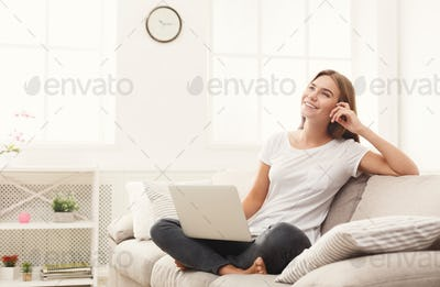 Young girl with laptop indoors