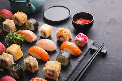 Sushi and rolls background, japanese cuisine