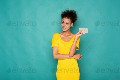 Smiling beautiful woman holding mobile phone