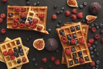 Round belgium waffles with berries top view