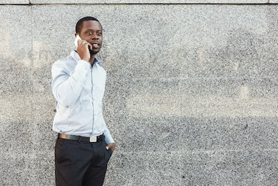 Portrait of a confident young black businessman talking on cell phone