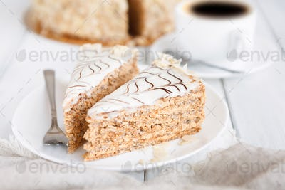 Esterhazy cake sliced on white plate close-up