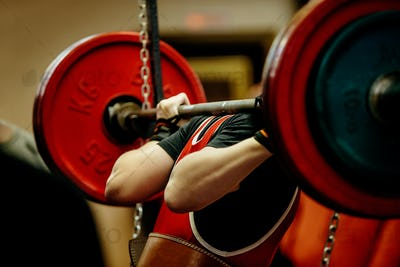 female powerlifter squat barbell