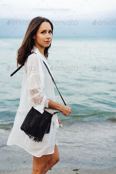 beautiful young girl with a handbag