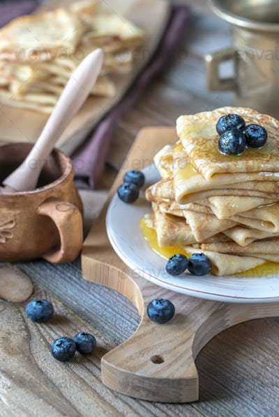 Crepes with fresh blueberries and honey