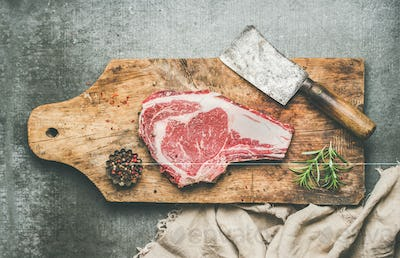 Meat dinner concept with raw uncooked beef steak rib-eye