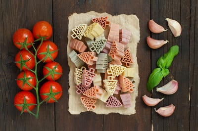 Tricolor fir tree shaped pasta, vegetables and herbs