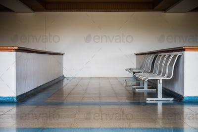 Small row of chairs in waiting room in Caribbean airport.