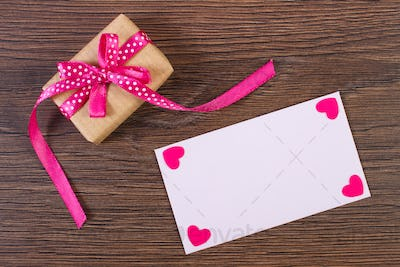 Gift with ribbon and love letter for Valentines Day