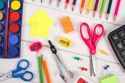 School accessories and shape of building on white boards