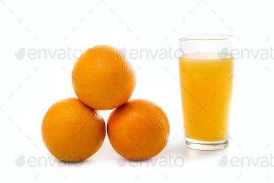 fresh sunkist orange with a glass of orange juice