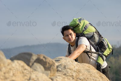 male hiker climb up the mountain