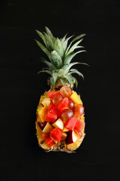 healthy fruit salad on pineapple for bowl