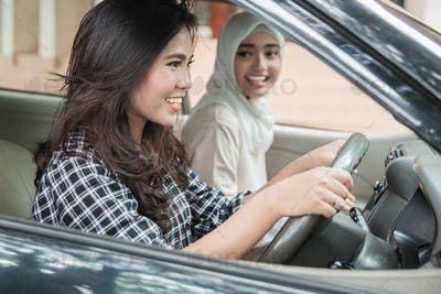 Two young women hangout on car trip