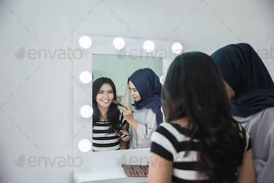 make up artist applying makeup