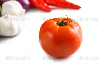fresh tomato with garlic and chili at the background