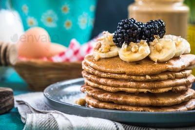 Close up of pancakes with fresh blackberries,banana and walnut