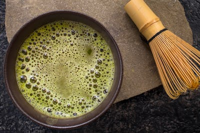 Matcha tea and whisk top