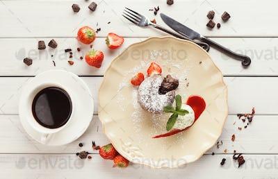 Chocolate fondant with vanilla ice cream and strawberry