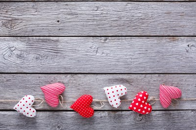 Valentine day background, pillow hearts border on wood