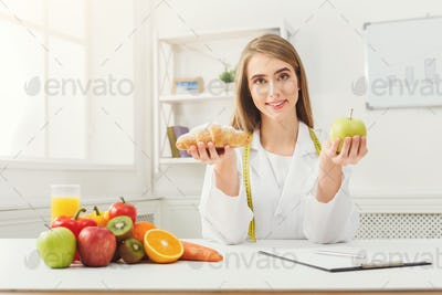Dietitian nutritionist with bun and apple