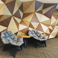 Modern hotel lobby with abstract wooden wall