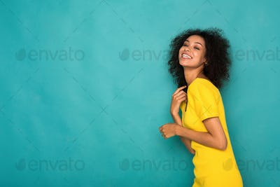 Cheerful african-american girl posing at studio