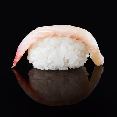 Seabass sushi on black mirroring background