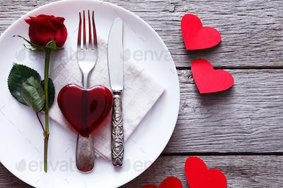 Valentine day background red glass heart on the plate