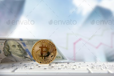 Bitcoin golden coin with financial chart and dollar background