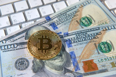 Bitcoin golden coin and dollar background