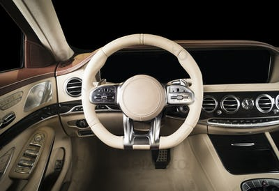 Modern luxury car red and white stitched leather interior