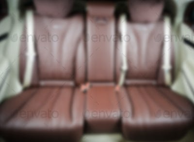 Blurred image of back passenger seats in modern luxury car