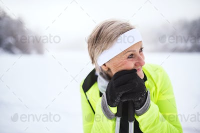 Senior woman skiing.