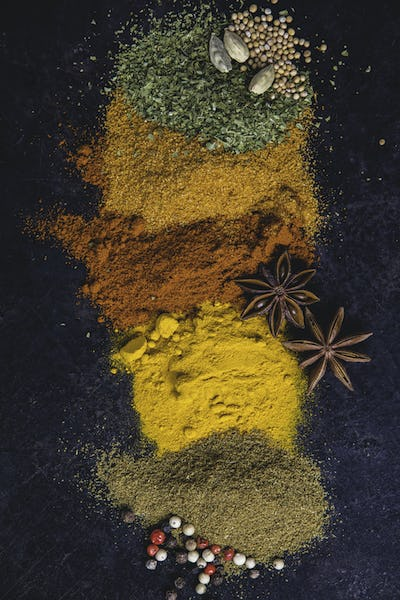 Spices and herbs on a dark background