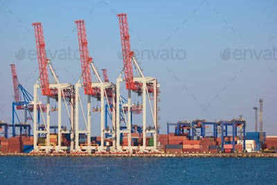 Cranes and containers in sea port.