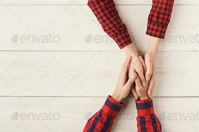 Top view of a male and female holding hands
