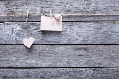 Valentine day , paper heart and card on wood background