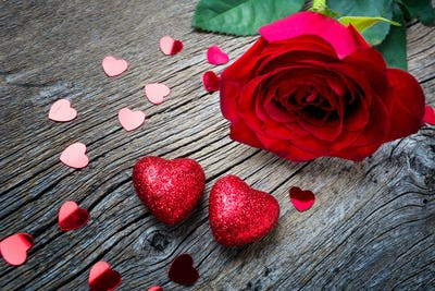 Valentines Day concept with red rose and hearts, copy space.