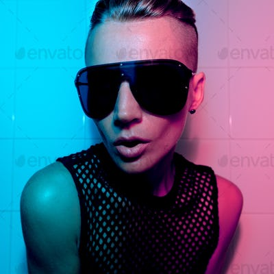 Tomboy Girl with short hair and luxury sunglasses. Fashion Party