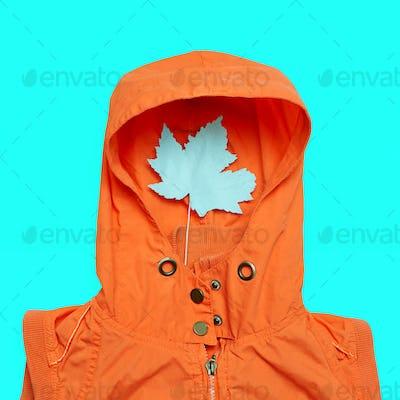 Minimal creative art. Jacket and a piece Hello rainy season