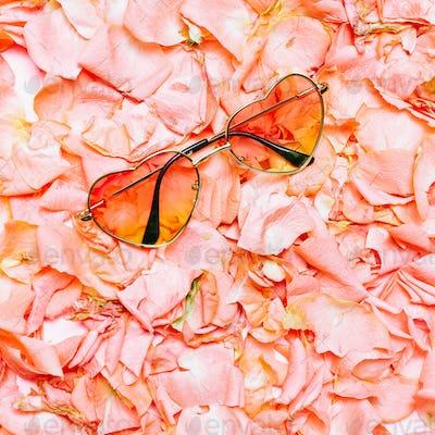 Minimal creative design. Glamorous sunglasses on flowers backgro